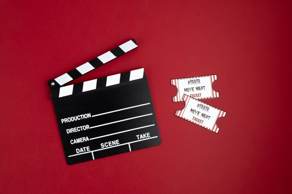 Movie clapperboard and halloween decoration. Horror movie night
